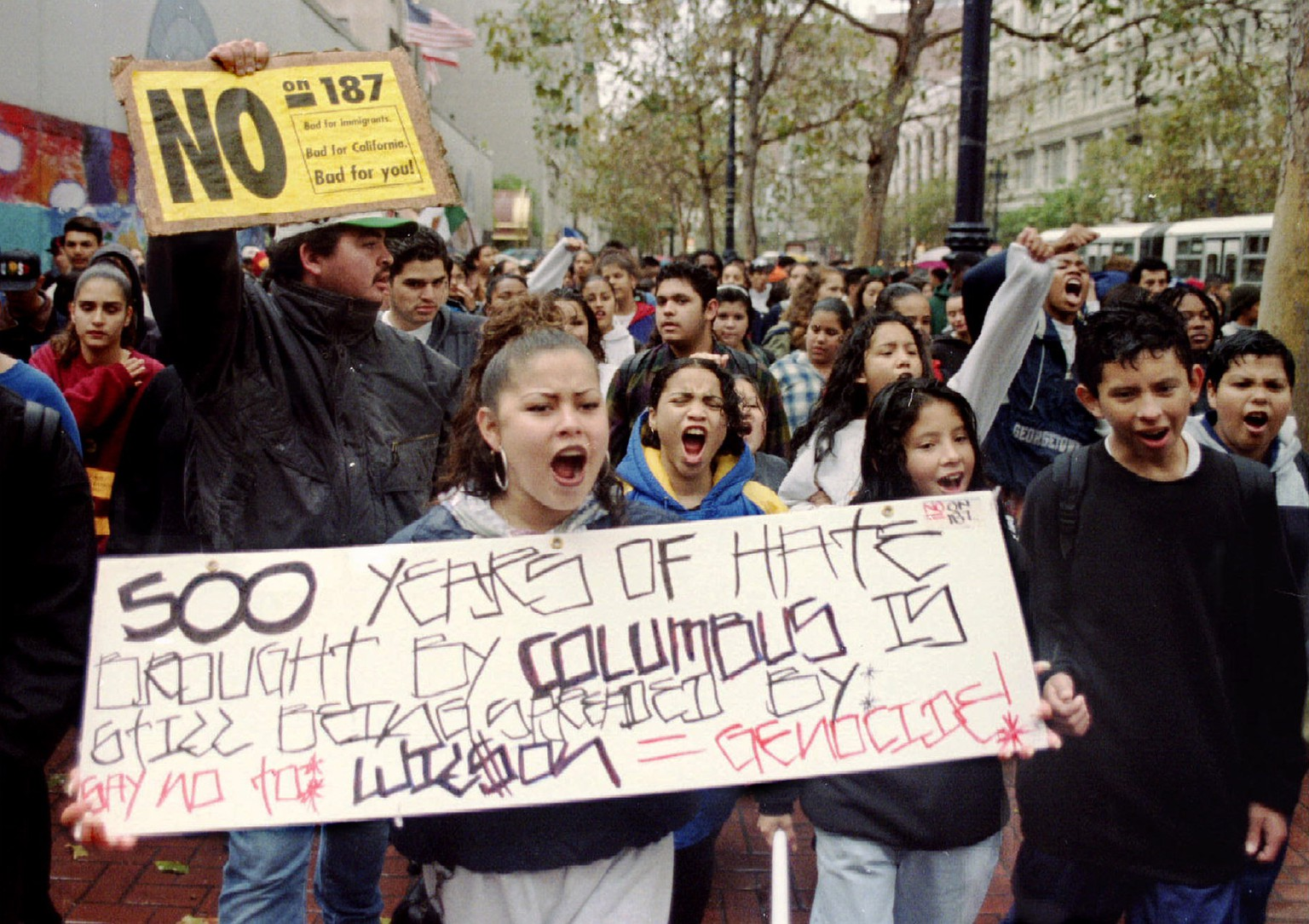 Hundreds of mainly Latino students chant as they march in downtown San Francisco November 9 to protest the passage of Proposition 187. Proposotion 187 approves a sweeping crackdown on illegal immigrants, denying them access to most public services - RTXF4U7