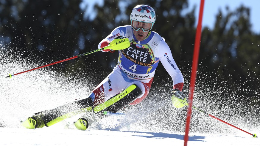 Switzerland's Daniel Yule competes during the first run of a men's alpine ski slalom, in Soldeu, Andorra, Sunday, March 17, 2019. (AP Photo/Alessandro Trovati)