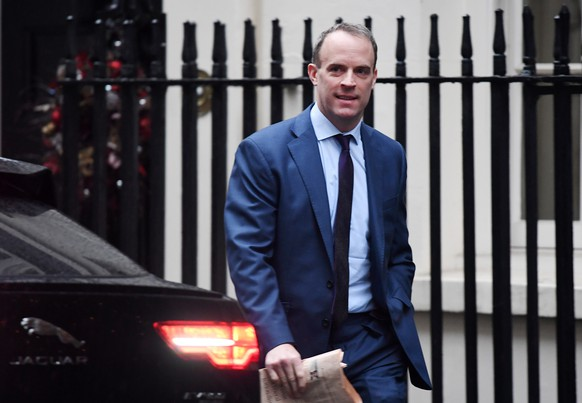 epa08076531 British Secretary of State for Foreign and Commonwealth Affairs, First Secretary of State Dominic Raab arrives at Downing Street in London, Britain, 17 December 2019, ahead of the first Cabinet meeting of the new Government.  EPA/ANDY RAIN