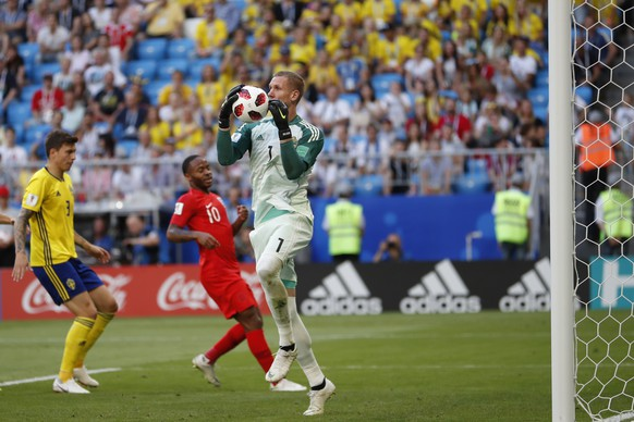Sweden goalkeeper Robin Olsen catches the ball during the quarterfinal match between Sweden and England at the 2018 soccer World Cup in the Samara Arena, in Samara, Russia, Saturday, July 7, 2018. (AP Photo/Francisco Seco)
