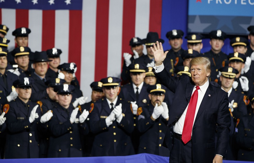 President Donald Trump waves after speaking to law enforcement officials on the street gang MS-13, Friday, July 28, 2017, in Brentwood, N.Y. (AP Photo/Evan Vucci)