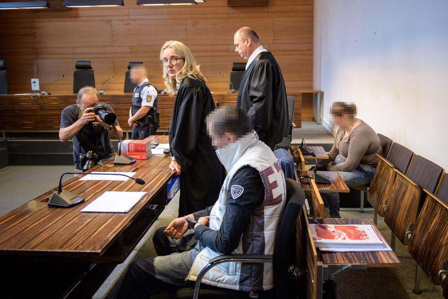 epa06799949 DefendantsChristian L. (C) and Berrin T. (R) wait with ther lawyers Martina Naegele and Matthias Wagner for the beginning of their trial on charges related to sexual abuse of a minor at the regional court in Freiburg, Germany, 11 June 2018. Christian L. and Berrin T. are accused of having offered Berrin's nine-year-old son in Staufen to paedophiles across Europe for sex in an abuse case that has shocked Germany. The couple ran their operation through the Darknet over a course of two years until police arrested them last September following information from the FBI.  EPA/Thomas Lohnes / POOL ATTENTION EDITORS: Pixelation done by source in accordance with court orders