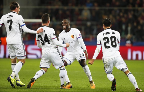 epa06274342 Taulant Xhaka (2-L) of Basel celebrates with his teammates after scoring the 1-0 lead during the UEFA Champions League group A soccer match between CSKA Moscow and FC Basel in Moscow, Russia, 18 October 2017.  EPA/YURI KOCHETKOV
