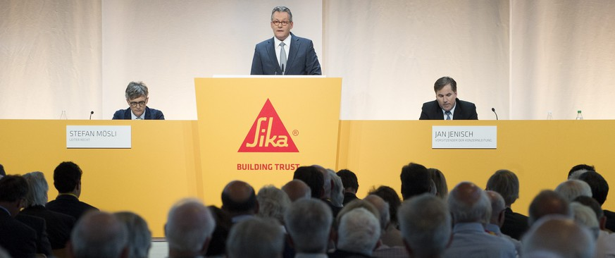 epa04704094 Paul Johann Haelg, Chairman of Sika, (C), speaks at the side of Stefan Moesli (L), Director of the legal department of Sika, and Jan Jenisch, Chief Executive Officer of Sika, uring the 2015 Annual General Meeting of Sika in Baar, Switzerland, 14 April 2015. The Management and the Board of Directors is still firmly opposed to the project of Schenker-Winkler Holding (SWH) to cede control of the French group Saint-Gobain. SWH represents the interests of the Burkard family, descendents of Sika's founder.  EPA/ANTHONY ANEX