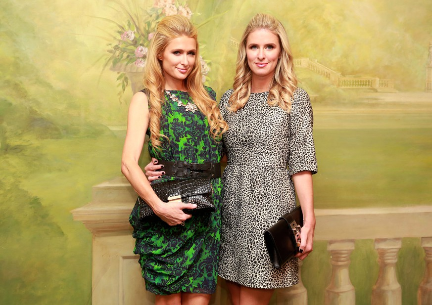 Paris Hilton and Nicky Hilton attend InStyle Magazine's 20th Anniversary Party at Diamond Horseshoe at the Paramount Hotel on Monday, Sept. 8, 2014, in New York. (Photo by Amy Sussman/Invision/AP)