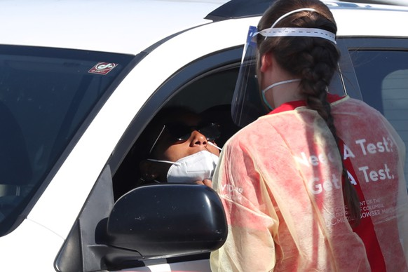 epa08646683 A person in a vehicle is tested with a swab at a drive-thru COVID-19 testing site operated by the District of Columbia, in Washington, ?DC, USA, 04 September 2020. Two unidentified vaccines for COVID-19 could be ready in October or November, the US Centers for Disease Control and Prevention (CDC) told public health agencies, according to news media reports.  EPA/MICHAEL REYNOLDS