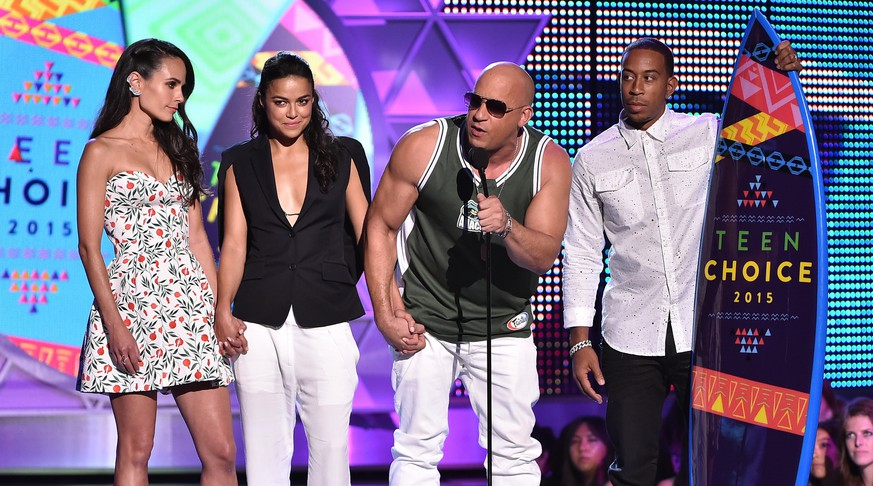 LOS ANGELES, CA - AUGUST 16:  (L-R) Actors Jordana Brewster, Michelle Rodriguez, Vin Diesel and Ludacris accept the Choice Movie: Action Award for Furious 7 onstage during the Teen Choice Awards 2015 at the USC Galen Center on August 16, 2015 in Los Angeles, California.  (Photo by Kevin Winter/Getty Images)
