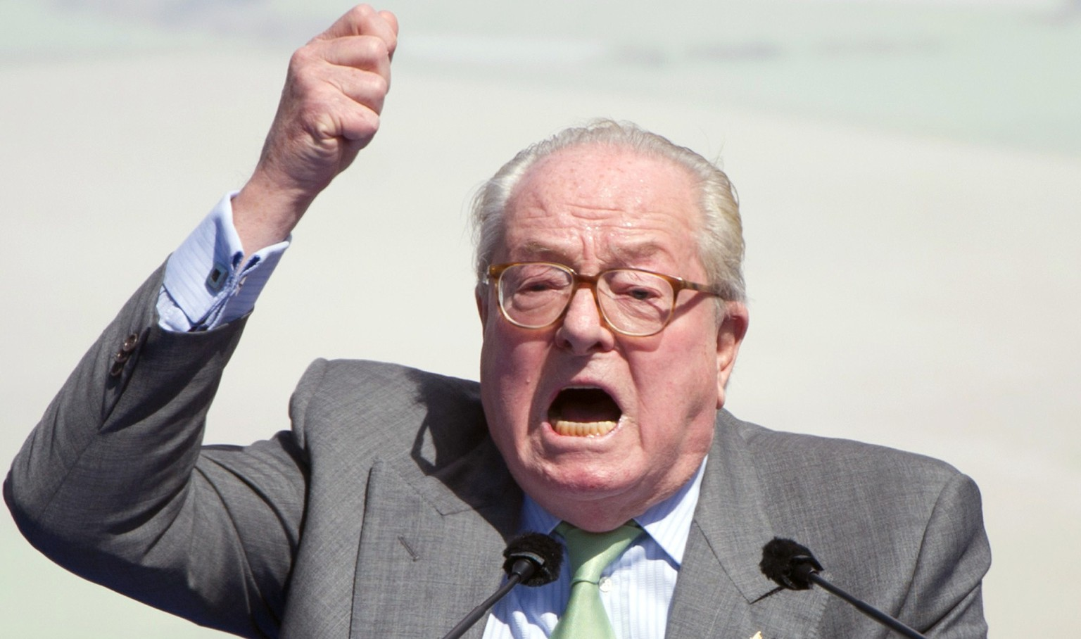(FILES) - A photo taken on May 1, 2012 in Paris shows French far right party Front National (FN) honour president, Jean-Marie Le Pen delivering a speech as part of the FN's annual celebration. Anti-racism campaigners reacted with outrage on June 8, 2014 to an apparent anti-Semitic pun by France's former far-right leader Jean-Marie Le Pen that even his own party and daughter were quick to criticise. Le Pen, who has had multiple convictions for inciting racial hatred and denying crimes against humanity, once described Nazi gas chambers as a