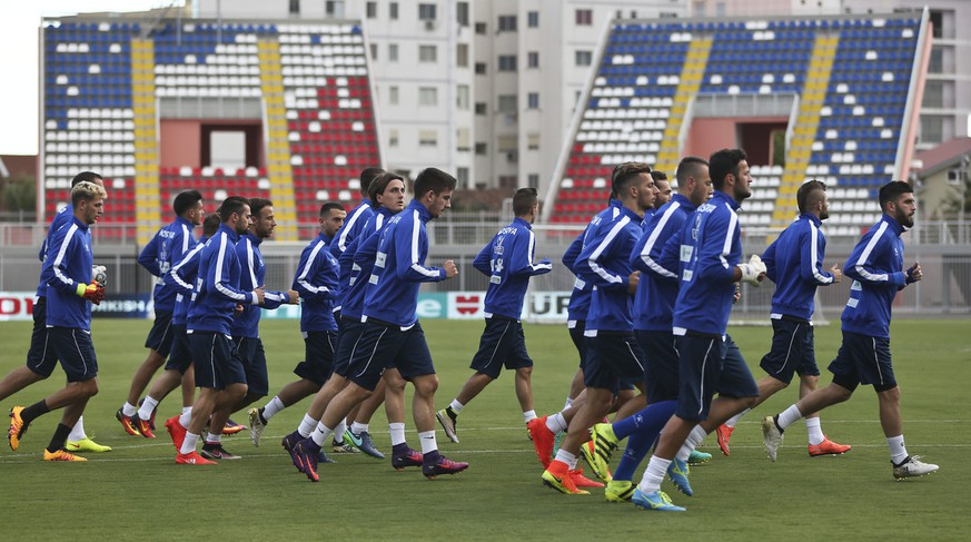 Kosovo's national team run during a training session ahead of the World Cup Group I qualifying soccer match between Kosovo and Croatia at Loro Borici in Shkodra, Albania on Wednesday, Oct. 5, 2016. (AP Photo/Visar Kryeziu)