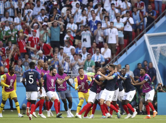France players celebrate after Kylian Mbappe scores his side's fourth goal during the round of 16 match between France and Argentina, at the 2018 soccer World Cup at the Kazan Arena in Kazan, Russia, Saturday, June 30, 2018. (AP Photo/Thanassis Stavrakis)