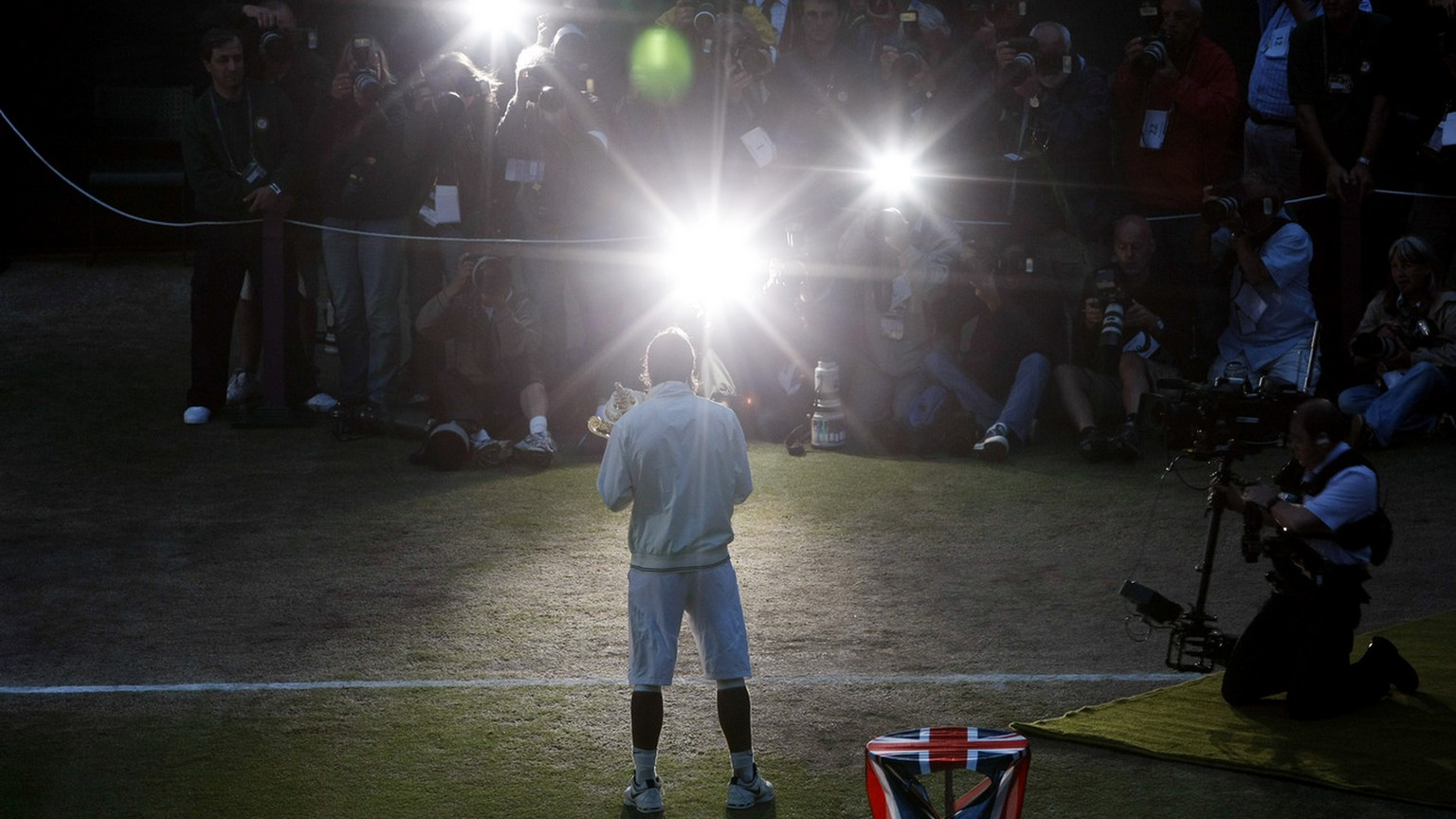 Spain's Rafael Nadal poses for photographers with his trophy after his win over Switzerland's Roger Federer in the men's singles final on the Centre Court at Wimbledon, Sunday, July 6, 2008. (AP Photo/Filipe Trueba,pool)