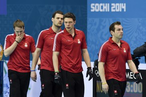 From right, Swiss skip Sven Michel, Claudio Paetz, Sandro Trolliet and Simon Gempeler during the men's curling round robin match between Switzerland and the US at the XXII Winter Olympics 2014 Sochi in Sochi, Russia, on Monday, February 17, 2014. (KEYSTONE/Laurent Gillieron)