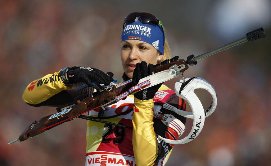 Magdalena Neuner of Germany prepares for a warm up shooting prior to the Women's 7.5 km Sprint competition at the Biathlon World Championships in Ruhpolding, Germany, Saturday, March 3, 2012. (AP Photo/Matthias Schrader)
