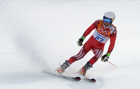 epa04087259 Gino Caviziel of Switzerland in action during the Men's Giant Slalom race at the Rosa Khutor Alpine Center during the Sochi 2014 Olympic Games, Krasnaya Polyana, Russia, 19 February 2014.  EPA/VASSIL DONEV