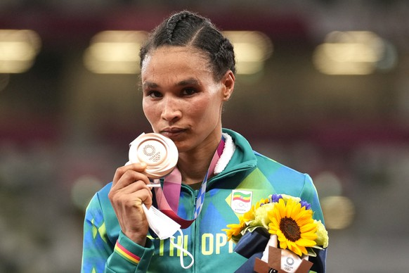 Bronze medalist Letesenbet Gidey, of Ethiopia, reacts during the medal ceremony for the women's 10,000-meters final at the 2020 Summer Olympics, Saturday, Aug. 7, 2021, in Tokyo. (AP Photo/Martin Meissner)