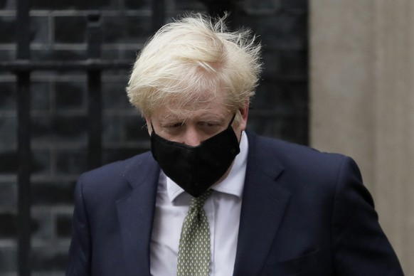 """Britain's Prime Minister Boris Johnson leaves Downing Street to attend parliament in London, Monday, Oct. 12, 2020. British Prime Minister Boris Johnson is expected to announce in Parliament on Monday a three-tier local lockdown system, formally known as """"Local COVID Alert Levels,"""" for England, his office said. (AP Photo/Kirsty Wigglesworth)"""