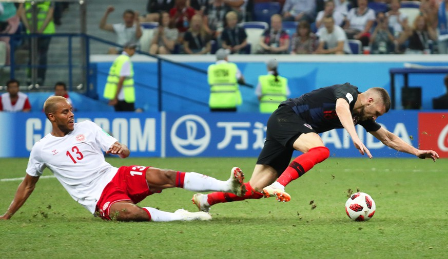 epa06856636 Ante Rebic (R) of Croatia is fouled by Mathias Jorgensen (L) of Denmark in the penalty box during the FIFA World Cup 2018 round of 16 soccer match between Croatia and Denmark in Nizhny Novgorod, Russia, 01 July 2018.