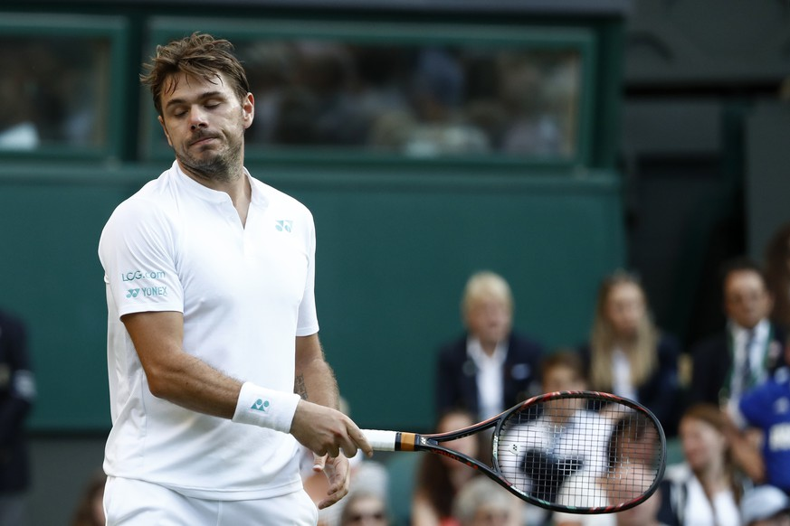 Stan Wawrinka of Switzerland reacts during his Men's Singles Match against Daniil Medvedev of Russia, on the opening day at the Wimbledon Tennis Championships in London Monday, July 3, 2017.(KEYSTONE/Peter Klaunzer)