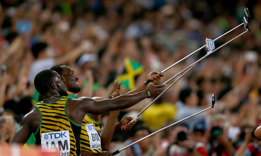 BEIJING, CHINA - AUGUST 29:  Nickel Ashmeade of Jamaica, Asafa Powell of Jamaica, Usain Bolt of Jamaica of Jamaica and Nesta Carter of Jamaica celebrate by taking a selfie after winning gold in the Men's 4x100 Metres Relay final during day eight of the 15th IAAF World Athletics Championships Beijing 2015 at Beijing National Stadium on August 29, 2015 in Beijing, China.  (Photo by Ian Walton/Getty Images)