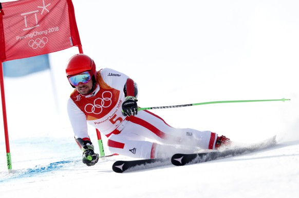 epa06537846 Marcel Hirscher of Austria in action during the Men's Giant Slalom first run at the Yongpyong Alpine Centre during the PyeongChang 2018 Olympic Games, South Korea, 18 February 2018.  EPA/GUILLAUME HORCAJUELO
