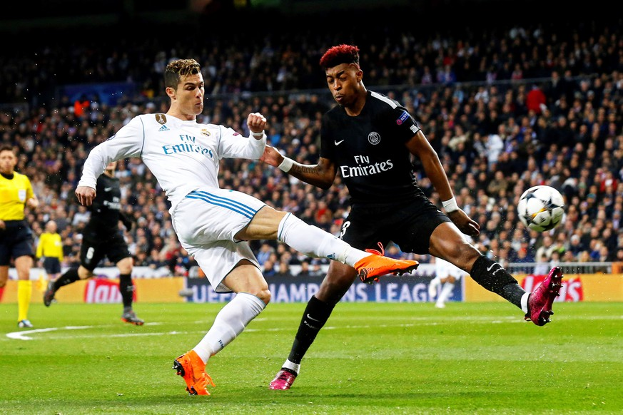 epa06525566 Paris Saint-Germain's Presnel Kimpembe (R) in action against Real Madrid's Cristiano Ronaldo (L) during the UEFA Champions League round of 16, first leg soccer match between Real Madrid and Paris Saint-Germain (PSG) at Santiago Bernabeu stadium in Madrid, Spain, 14 February 2018.  EPA/KIKO HUESCA