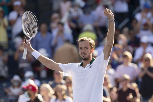 Russia's Daniil Medvedev celebrates after beating Reilly Opelka, of the United States, 6-4, 6-3 to win the National Bank Open men's tennis final in Toronto, Sunday, Aug. 15, 2021. (Chris Young/The Canadian Press via AP)