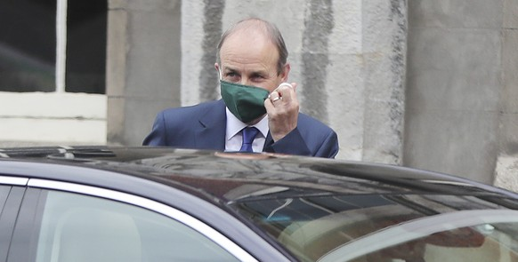 Irish Prime Minister Micheal Martin arrives for a Cabinet meeting at Dublin Castle, Ireland, Monday July 6, 2020.  Centrist politician Micheal Martin leads a coalition government of two longtime rival parties. (Niall Carson/PA via AP)