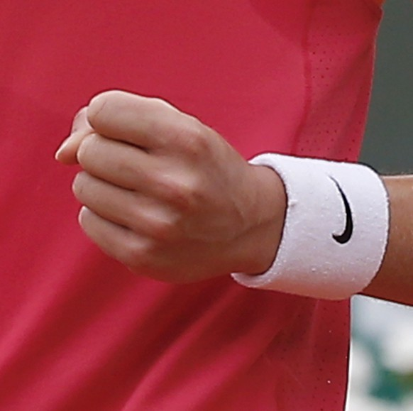 Canada's Eugenie Bouchard clenches her fist after scoring a point during the fourth round match of the French Open tennis tournament against Germany's Angelique Kerber at the Roland Garros stadium, in Paris, France, Sunday, June 1, 2014.  (AP Photo/Michel Euler)