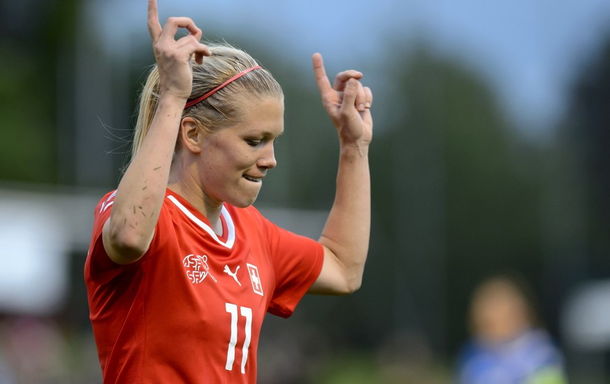 Swiss players, Lara Dickenmann, celebrates after scoring a goal, during the FIFA Women's world cup 2015 qualification soccer match between Switzerland and Iceland at the Colovray Stadium in Nyon, Switzerland, Thursday, May 8, 2014. (KEYSTONE/Martial Trezzini)