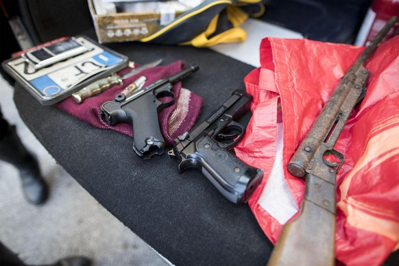 epa06355115 Weapons seized during extraordinary checks and searches in Ostia, Rome district, Italy, 28 November 2017. State, Carabinieri and finance police in Ostia on 28 November 2017 amid fears that a clan war may be developing in the Rome seaside district, sources said. The operations were designed to find arms and drugs, sources said.  EPA/MASSIMO PERCOSSI