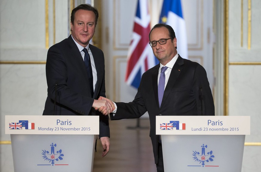 epa05038820 British Prime Minister David Cameron (L) and French President Francois Hollande shake hands during a joint press conference following a meeting at the Elysee Palace in Paris, France, 23 November 2015. Hollande and Cameron pledged to step up counterterrorism measures after the terror attacks in Paris, which left 130 dead and hundreds injured. They discussed the fight against Islamic State, which claimed responsibility for the Paris attacks, as the French president pushes for a stronger international coalition against the Sunni extremist group. They also agreed to increase information-sharing efforts.  EPA/THEO DUVAL/POOL