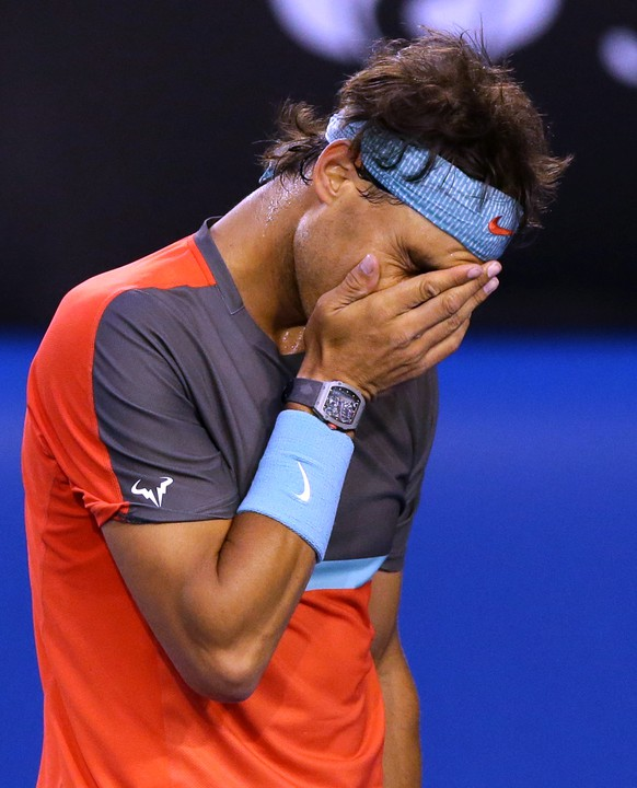 Rafael Nadal of Spain reacts after losing a point to Roger Federer of Switzerland during their semifinal at the Australian Open tennis championship in Melbourne, Australia, Friday, Jan. 24, 2014.(AP Photo/Aaron Favila)