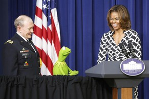 Chairman of the Joint Chiefs of Staff U.S. Army General Martin Dempsey (L-R), Kermit the Frog and first lady Michelle Obama introduce a showing of the new movie Muppets Most Wanted for children of U.S. military families at the White House in Washington March 12, 2014.  REUTERS/Jonathan Ernst    (UNITED STATES - Tags: POLITICS ENTERTAINMENT)