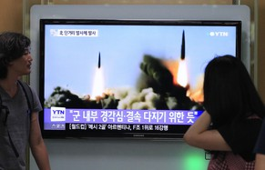 "People watch a TV news program showing the missile launch conducted by North Korea, at Seoul Railway Station in Seoul, South Korea, Thursday, June 26, 2014. North Korea fired three short-range projectiles Thursday into the waters off its east coast, a South Korean defense official said. The move was most likely a routine test-firing, but the official said it could also be meant to stoke tensions with Seoul. The writing on the screen reads ""The missiles were launched to alert and express its internal solidarity."" (AP Photo/Ahn Young-joon)"