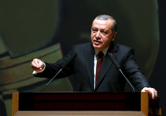 Turkish President Tayyip Erdogan addresses the war academy in Istanbul, Turkey March 28, 2016, in this handout photo provided by the Presidential Palace. REUTERS/Kayhan Ozer/Presidential Palace/Handout via Reuters ATTENTION EDITORS - THIS IMAGE WAS PROVIDED BY A THIRD PARTY. REUTERS IS UNABLE TO INDEPENDENTLY VERIFY THE AUTHENTICITY, CONTENT, LOCATION OR DATE OF THIS IMAGE. FOR EDITORIAL USE ONLY. NOT FOR SALE FOR MARKETING OR ADVERTISING CAMPAIGNS. FOR EDITORIAL USE ONLY. NO RESALES. NO ARCHIVE. THE PICTURE IS DISTRIBUTED EXACTLY AS RECEIVED BY REUTERS, AS A SERVICE TO CLIENTS.