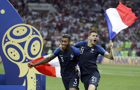 France's Presnel Kimpembe and Lucas Hernandez celebrate after the final match between France and Croatia at the 2018 soccer World Cup in the Luzhniki Stadium in Moscow, Russia, Sunday, July 15, 2018. France won the final 4-2. (AP Photo/Matthias Schrader)