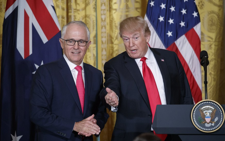 epa06559011 US President Donald J. Trump (R) and  Prime Minister of Australia Malcolm Turnbull (L) walk from the stage following  a joint press conference in the East Room of the White House in Washington, DC, USA, 23 February 2018.  EPA/SHAWN THEW
