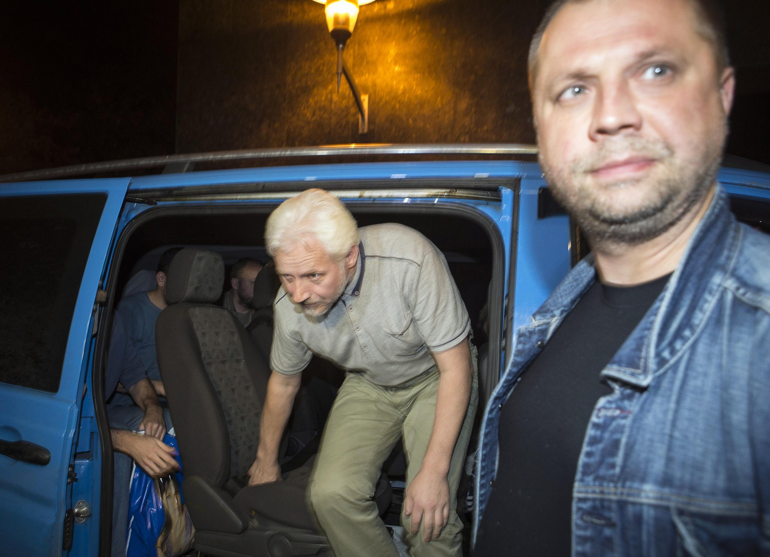 "An unidentified member of OSCE Special Monitoring Mission in Ukraine gets out of a vehicle next to Alexander Borodai (R), Prime Minister of the self proclaimed ""Donetsk People's Republic"", on arrival to the city of Donetsk after been released from captivity, June 27, 2014.  REUTERS/Shamil Zhumatov  (UKRAINE - Tags: POLITICS CIVIL UNREST TPX IMAGES OF THE DAY)"