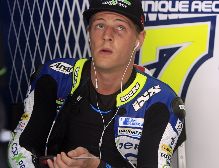 Moto2 rider Dominique Aegerter of Switzerland sits in his pit garage before a free practice ahead of Sunday's Malaysian Motorcycle Grand Prix in Sepang, Malaysia, Friday, Oct. 24, 2014. (AP Photo/Lai Seng Sin)