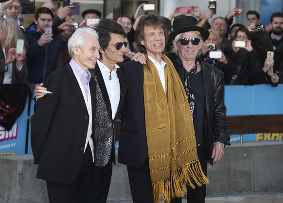 FILE - This April 4, 2016 file photo shows members of The Rolling Stones, from left, Charlie Watts, Ronnie Wood, Mick Jagger and Keith Richards at the Rolling Stones Exhibitionism preview in London. The Rolling Stones will join Lady Gaga, Paul McCartney, Stevie Wonder and Billie Eilish for the upcoming TV special aimed at fighting the coronavirus pandemic. Advocacy organization Global Citizen announced Friday that the Stones will appear Saturday on â??One World: Together At Home,â? a two-hour televised event that will air at 8 p.m. Eastern simultaneously on ABC, NBC, CBS, iHeartMedia and Bell Media networks. (Photo by Joel Ryan/Invision/AP, File) Charlie Watts,Ronnie Wood,Mick Jagger,Keith Richards