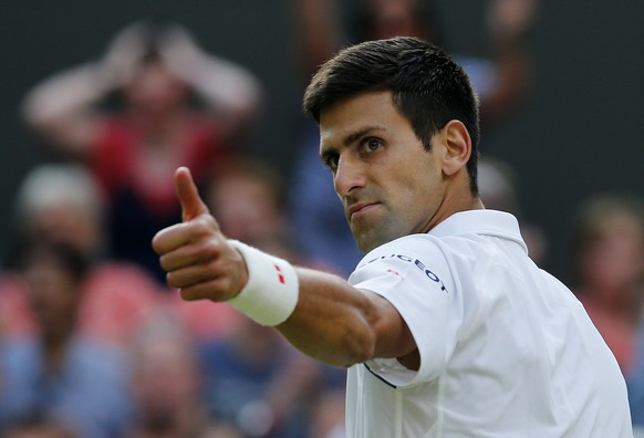 Novak Djokovic of Serbia gives a thumbs up to Marin Cilic of Croatia during their match at the Wimbledon Tennis Championships in London, July 8, 2015.                           REUTERS/Suzanne Plunkett