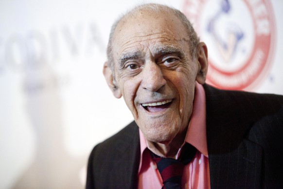 Actor Abe Vigoda smiles as he attends the Friars Club Roast of Betty White in New York in this file photo from May 16, 2012. Vigoda, an American actor best known for roles in