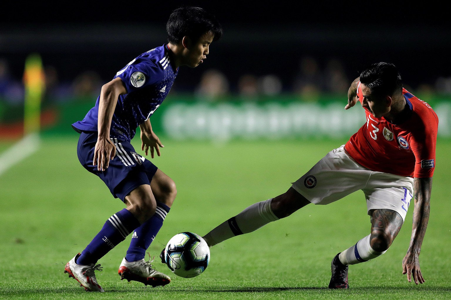 epa07654828 Takefusa Kubo (L) of Japan in action against Erick Pulgar (R) of Chile during the Copa America 2019 Group C soccer match between Japan and Chile, at Morumbi Stadium in Sao Paulo, Brazil, 17 June 2019.  EPA/Fernando Bizerra