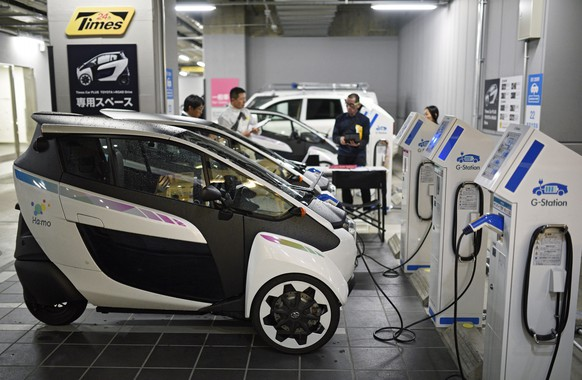 epa04702602 Toyota Motor Corp. compact three-wheeled electric vehicle 'i-Road' are parked at a pick-up station in Yurakucho, central Tokyo, Japan, 13 April 2015. From 10 April, Toyota Motor Corp. and Park24 Co., Ltd. started a car sharing service trial in central Tokyo by providing the 'i-Road', the giant automaker's three-wheeled electric vehicle. By using the 'Times Car Plus' service, members can use the vehicles at any time during the trial period ending in September 2015. Usage cost is 412 yen (about 3 euros) for 15 minutes.  EPA/FRANCK ROBICHON