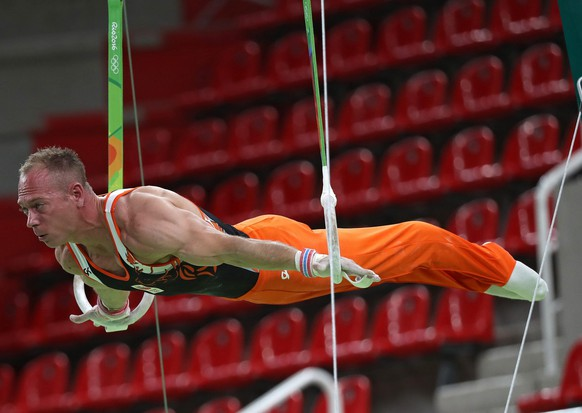 epa05453502 Artistic gymnast Yuri van Gelder of Netherlands practice on the rings during a training session for the Rio 2016 Olympic Games at the Rio Olympic Arena in Rio de Janeiro, Brazil, 03 August 2016.  EPA/HOW HWEE YOUNG