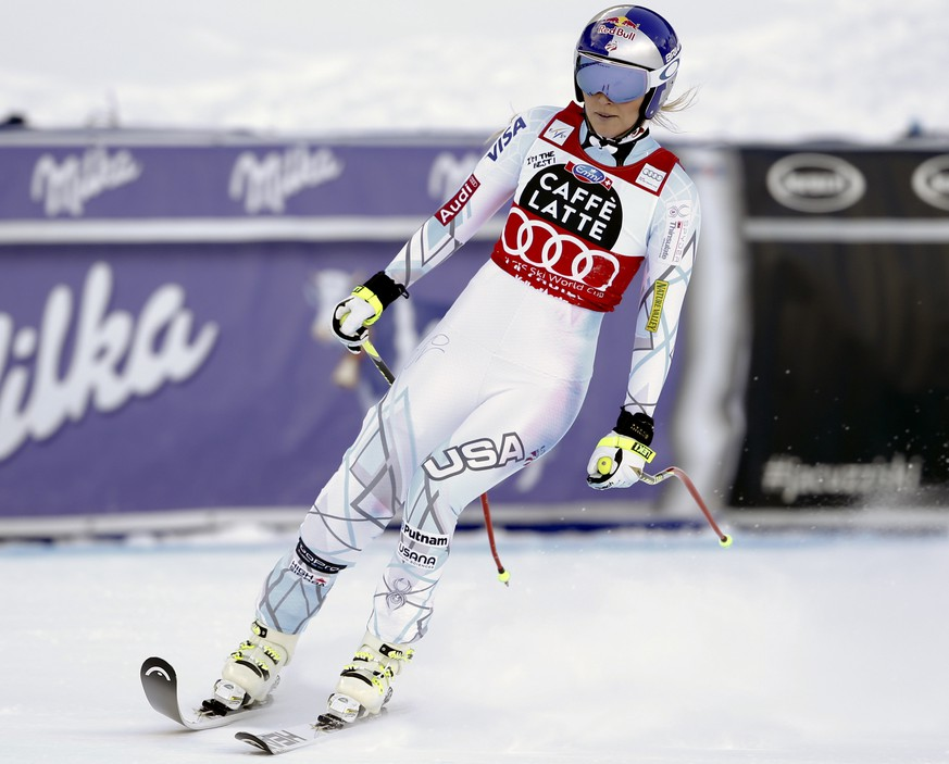 United States' Lindsey Vonn arrives at the finish area after crashing during a women's Alpine ski downhill race, in La Thuile, Italy, Friday, Feb. 19, 2016. (AP Photo/Alessandro Trovati)