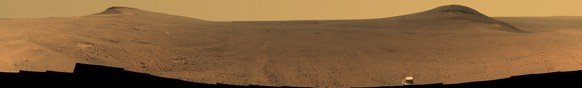 This composite image made from June 7-19, 2017 photos shows the scene from NASA's Opportunity rover outside Endeavor Crater on the planet Mars. Flight controllers have been on the alert for a message from Opportunity ever since a dust storm enveloped Mars in June and contact was lost. The storm has finally diminished in August 2018. (NASA/JPL-Caltech/Cornell/Arizona State University via AP)