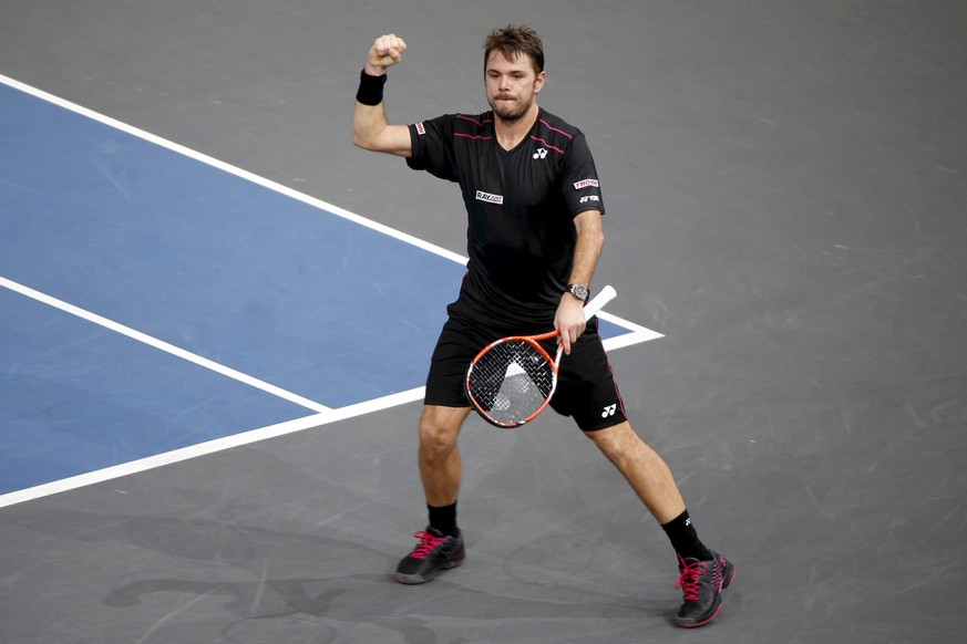 Stan Wawrinka of Switzerland reacts after defeating Rafael Nadal of Spain in their men's singles quarter-final tennis match at the Paris Masters tennis tournament at the Bercy sports hall in Paris, France, early November 7, 2015. REUTERS/Charles Platiau