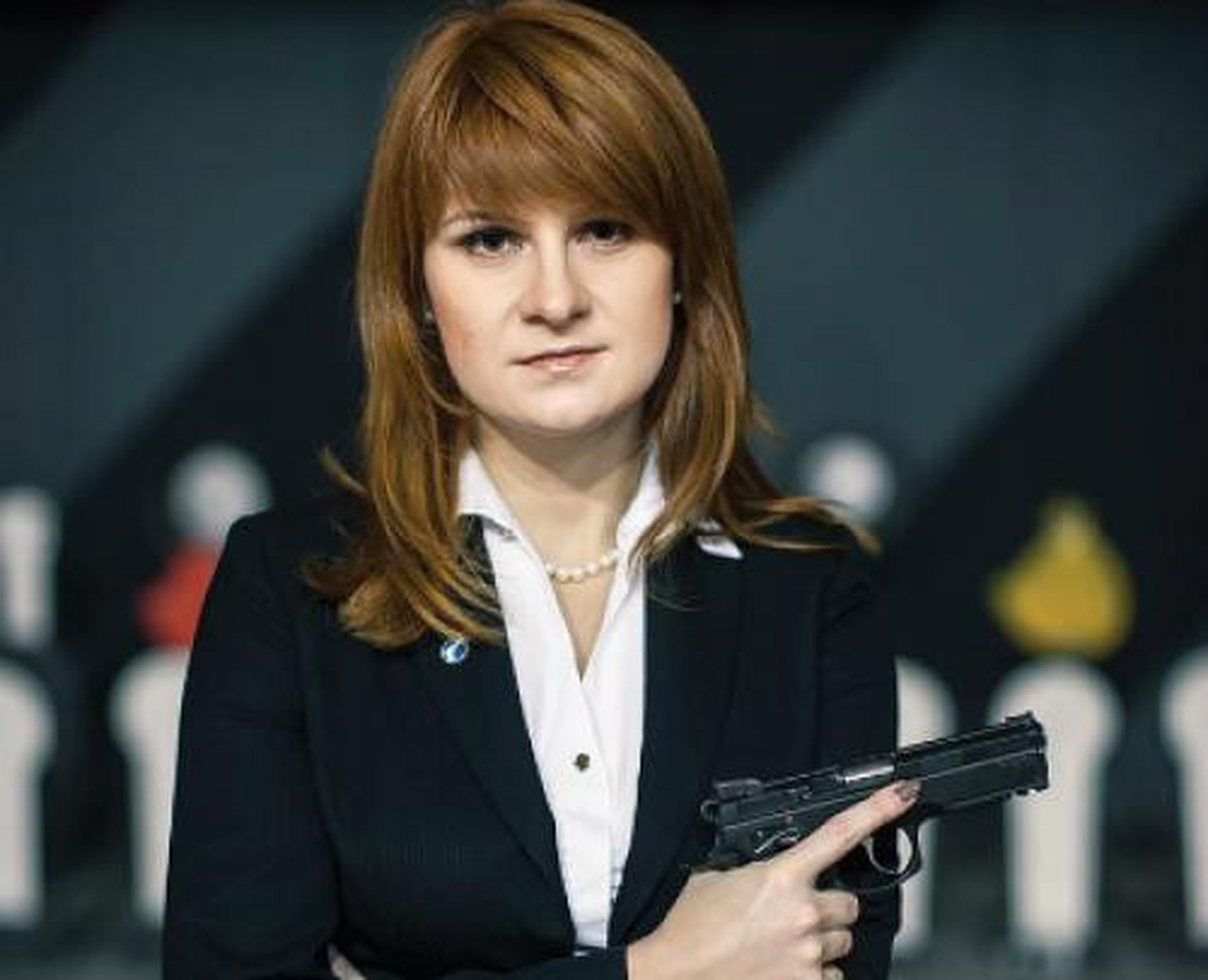 epa06897776 An undated handout picture made available by the Press Service of the Civic Chamber of the Russian Federation on chamber's official website shows  'The Right to Bear Weapons' Public Organization's Board Chairman Maria Butina posing with a gun in Moscow, Russia. Russian citizen Maria Butina, 29, was arrested in the United States on suspicion of being engaged in conspiracy against the U.S. and acting as an unregistered Russian agent.  EPA/Press Service of Civic Chamber of the Russian Federation/HANDOUT  HANDOUT EDITORIAL USE ONLY/NO SALES