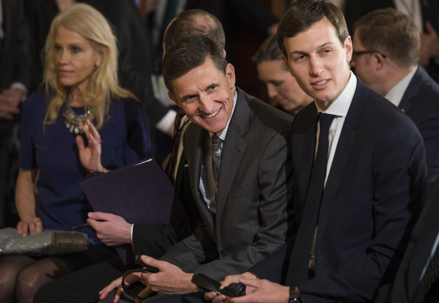 epa05791639 Embattled National Security Advisor Michael Flynn (C) flanked by Kellyanne Conway (L) and Jared Kushner (R) attends a press conference with US President Donald J. Trump and Canadian Prime Minister Justin Trudeau in the East Room of the White House in Washington, DC, USA, 13 February 2017. Flynn is facing growing scrutiny for discussing U.S. sanctions against Russia with the Russian ambassador to the U.S. prior to Trump taking office.  EPA/JIM LO SCALZO